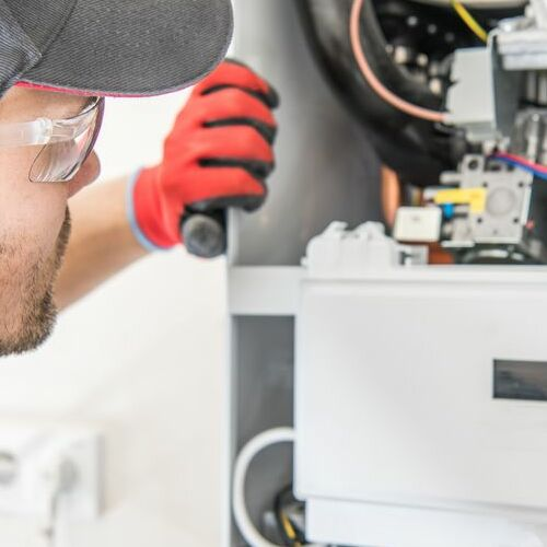 A Technician Checks a Heater.
