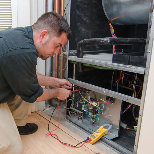 A Technician Services an HVAC System.