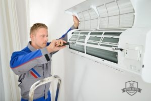 Technician Completing Ductless Air Conditioning Repair